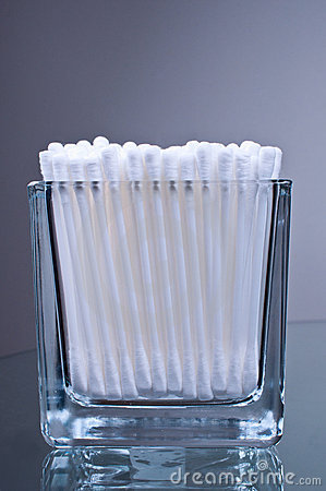 Cotton buds in glass