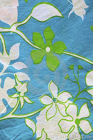 Cotton material with leaf and flower patterns.