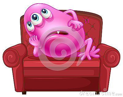 A couch with a pink monster