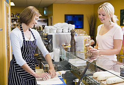 Counter customer restaurant serving woman