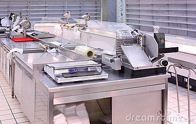 Counter with trading equipment in empty shop