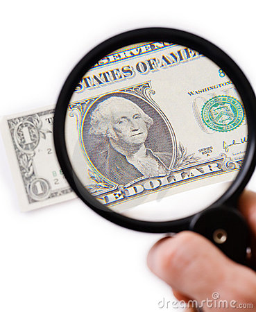 Counterfeit dollar on magnifier