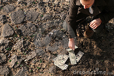 Counting cash on the ground