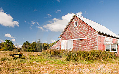 Country barn in autumn field