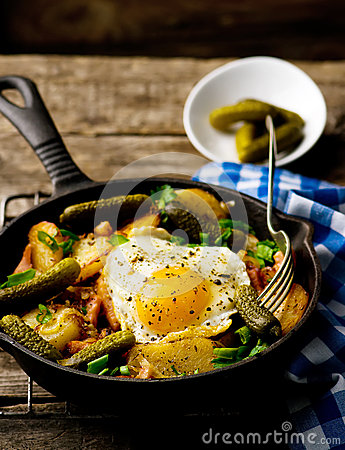 Free Country Breakfast From Potatoes, With Bacon And Fried Eggs Stock Images - 63907254