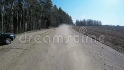 Country driving car on gravel road using a fisheye lens. Slow motion.  stock video