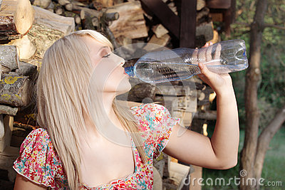 Country girl  drinking water