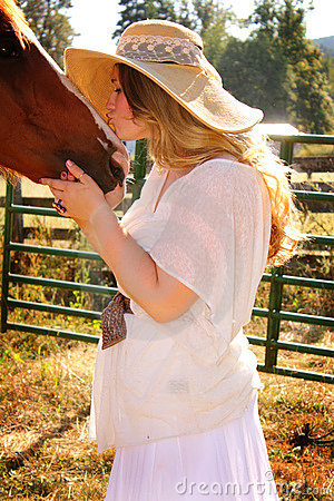 Country Girl Gives Horse A Kiss