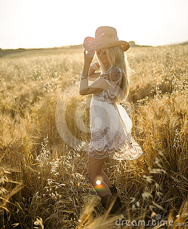 Country girl in hay field 2