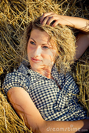 Country girl lying on the haystack