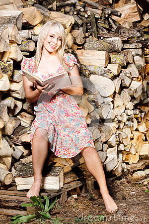 Country girl reading a book