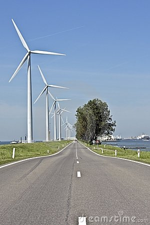 Countryroad and windmills in the Netherlands