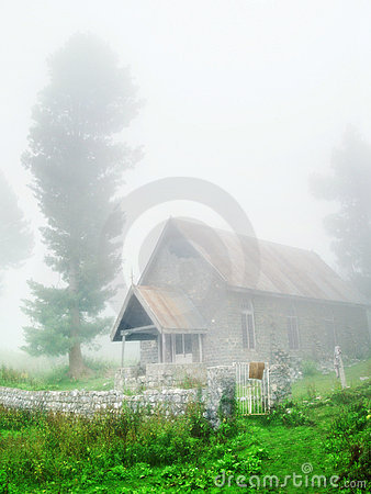 Countryside church in fog