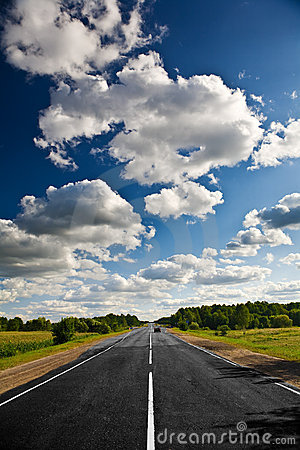 Countryside road under clouds
