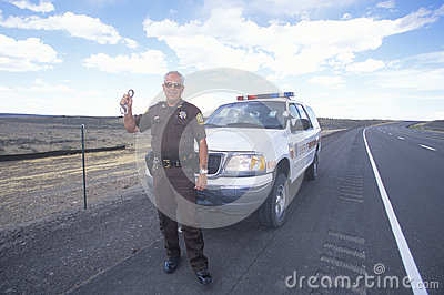 County sheriff with handcuffs Editorial Stock Image
