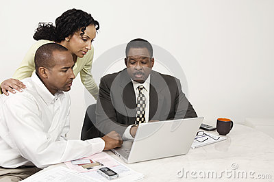 Couple and Accountant Using Laptop