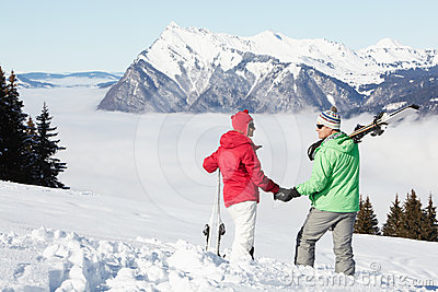 Couple Admiring Mountain View In Mountains
