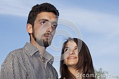 Couple against sky
