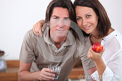 Couple with an apple