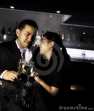 Couple at bar with champagne