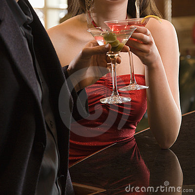 Couple at bar with drinks.