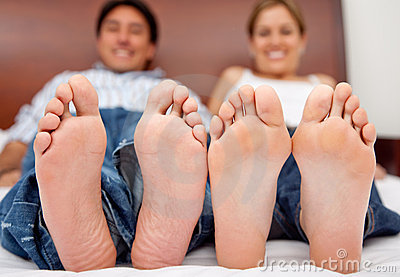 Couple barefoot on the bed