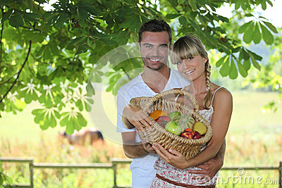 Couple with a basket of fruits