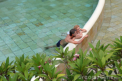 Couple bathing in hotel pool