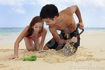 Couple on the beach digging