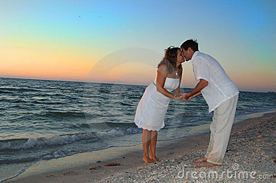 Couple on beach kissing