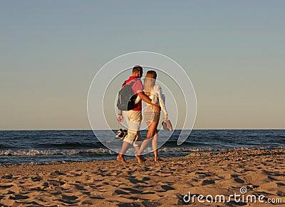 Couple during a beach stroll #2