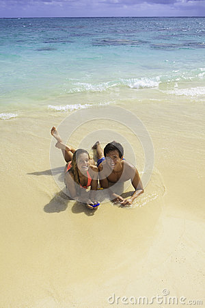 Couple on the beach texting