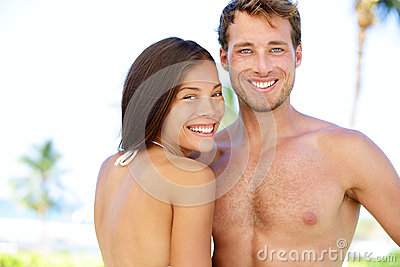 Couple beach - young multicultural people