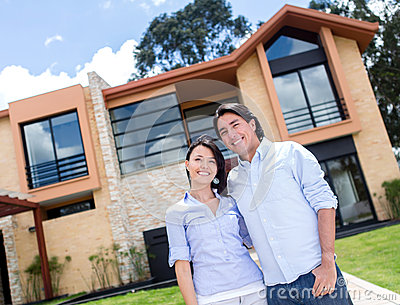 Couple with a beautiful house