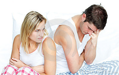 Couple in bed and getting sad