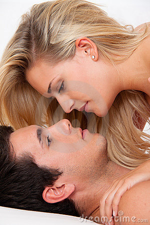 Couple in bed with sex and affection