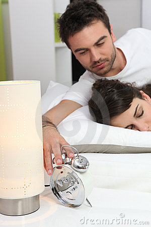 Couple in bed waking up