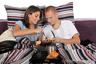 Couple, bedroom breakfast