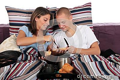 Couple, bedroom breakfast
