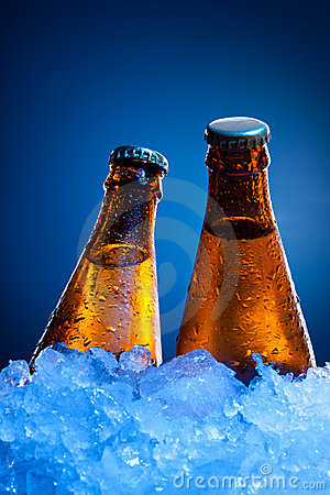Couple beer bottles in ice