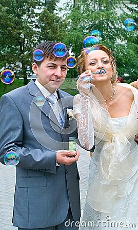 Couple blowing the soap bubbles