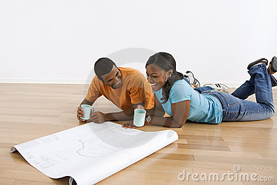 Couple with blueprints.