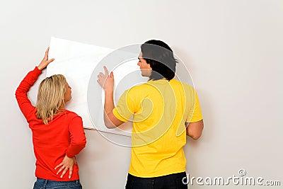 Couple with blueprints, focus on blueprints