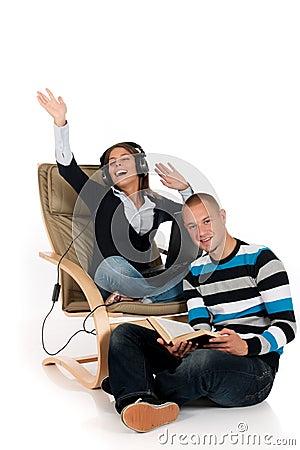 Couple, book laptop sofa
