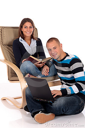 Couple, book laptop sofa
