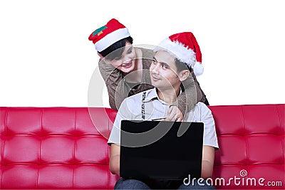 Couple buying christmas gift online - isolated