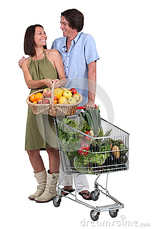 Couple buying fruit and vegetables