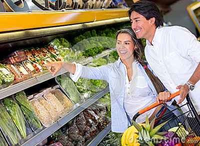Couple buying groceries