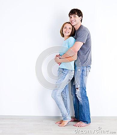 Couple in casuals in empty room