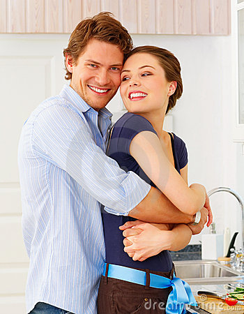 Couple in casuals enjoying a goodtime in kitchen